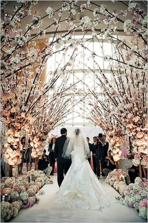 Trees in the Chapel... church wedding idea. (: you could do a pretty curtain with a first communion table..
