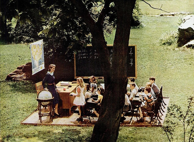 An outdoor classroom - complete with magic floating map - from a 1945 General Electric ad. #vintage #1940s #school #students #teacher #ads