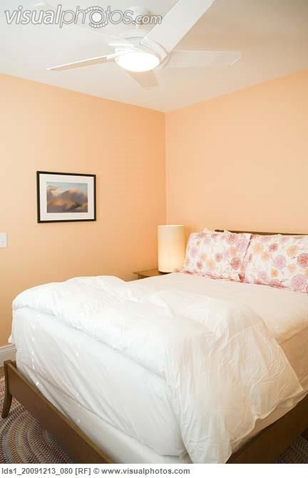 white and peach bedroom with beach scenery accent mural