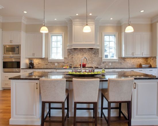 White Kitchen Island With Brown Granite Countertops Also Beige Wooden