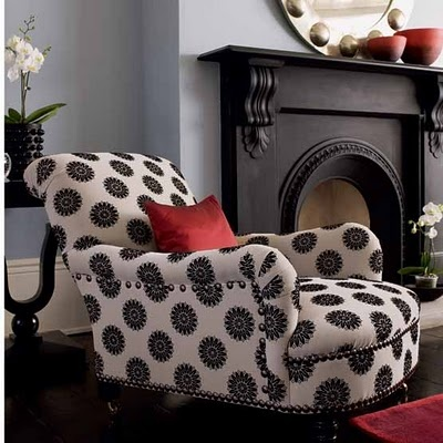Black and white chair, red accent pillow