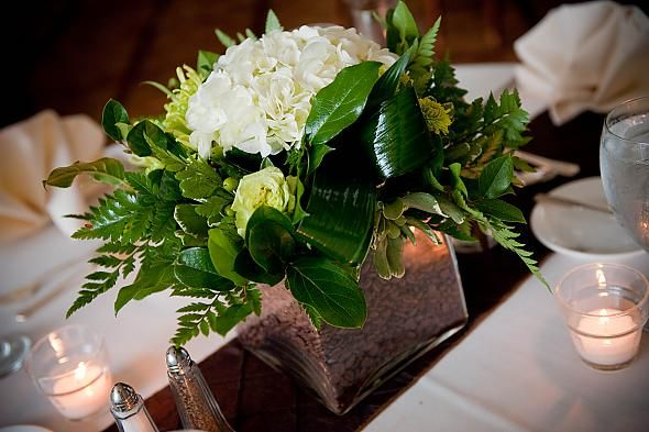 White hydrangea and greenery centerpiece vased flowers