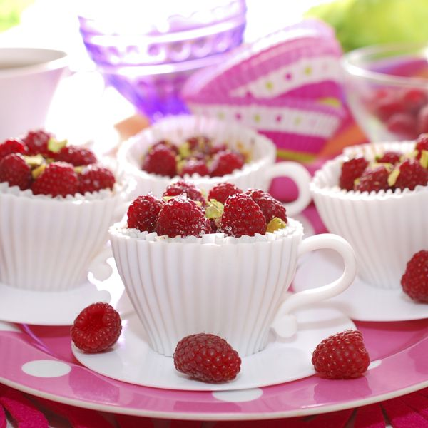 raspberry cupcakes served topped with fresh berries and pistachios ...