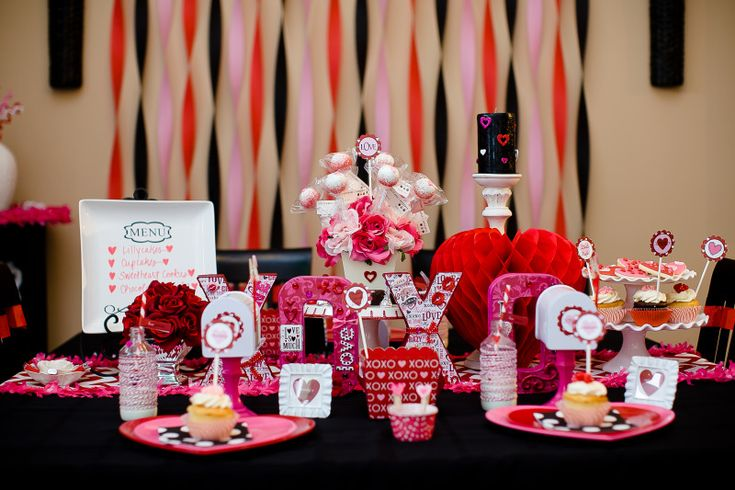 Beautiful Valentines Day Party Table with Streamer Backdrop