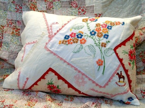 vintage hankies on a pillow case.