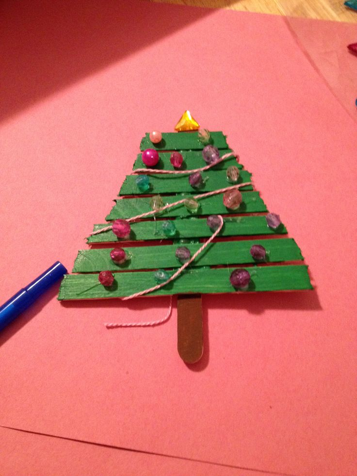 Popsicle stick christmas tree crafts christmas pinterest for Christmas projects with popsicle sticks