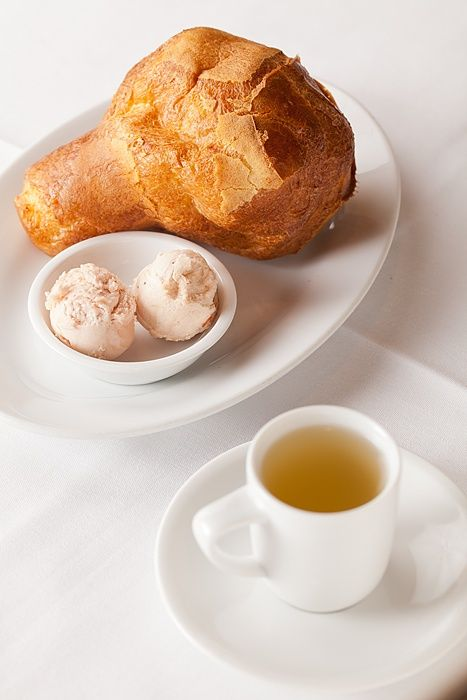 An afternoon snack: A popover with strawberry butter and green tea.