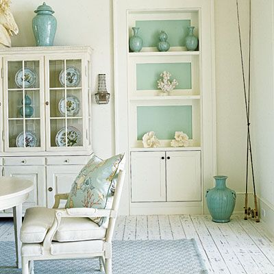 Aqua paint on the back of these shelves makes accessories stand out.