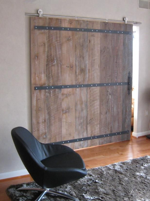 living room sliding barn door and chair on hgtv