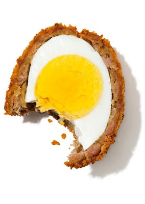 Scotch eggs–the gastropub staple–cooked eggs swaddled in sausage ...