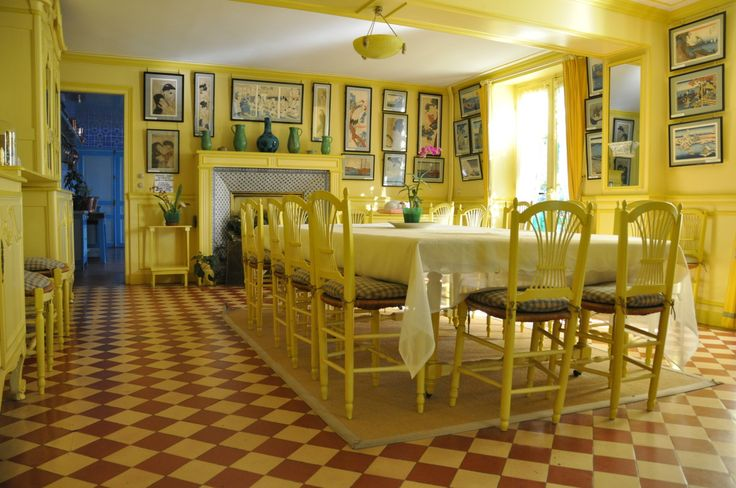 The spectacular yellow dining room at Monet's house in Giverney