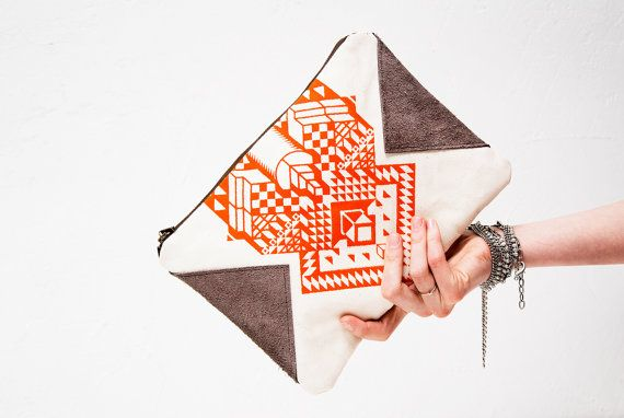 Tangerine Geometrical Illusion Printed  Leather Pouch >> Love the suede details. Handheld awesomeness.