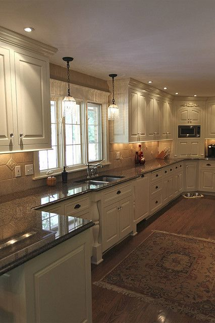 creamy white cabinets ~ needs brushed bronze knobs and pulls ~ needs dark walnut floors ~ LOVE the window