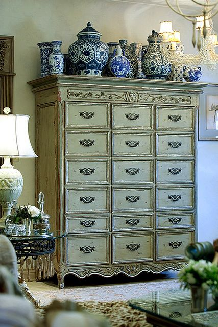 I love the armoire/chest of drawers and collection of blue and white porcelain