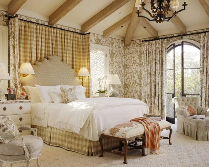 French Country, cheerful feeling created by room, exposed beams on the ceiling, earthy tones, many different patterns, very feminine, painted wood