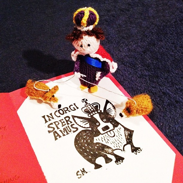 Whodunnknit Pix: Little knitted Queen and tiny corgis admire lovely corgi print from @jabberworks. #stitchlondon #jubilee by Deadly Knitshade, via Flickr