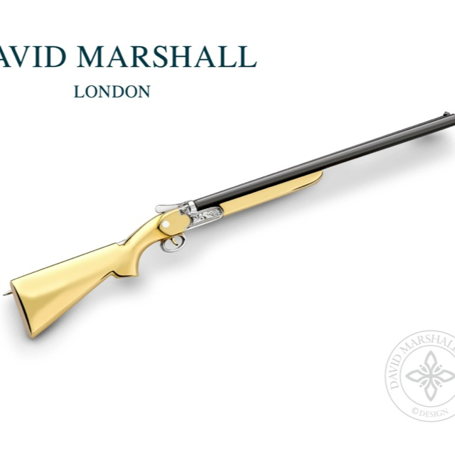 Shotgun pin yellow & white gold stock and mechanism with steel barrels and a diamond sight 80mm long and it splits like the real thing Raised £5,000 for charity