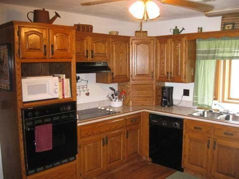 How to update outdated oak kitchen cabinets good questions for Kitchen cabinets upgrade