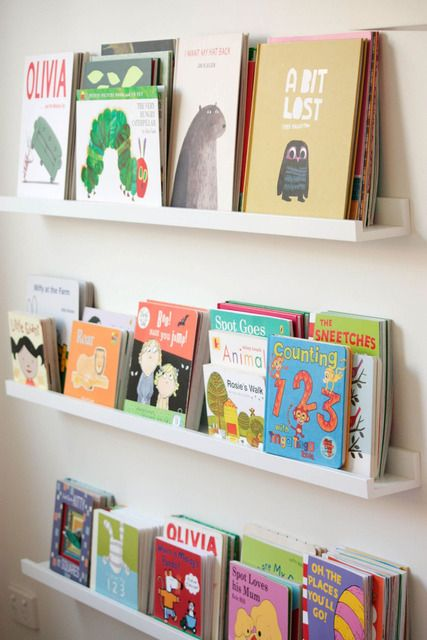 Awesome idea for books in a kid's room. The picture ledges are from Ikea! $10 each!