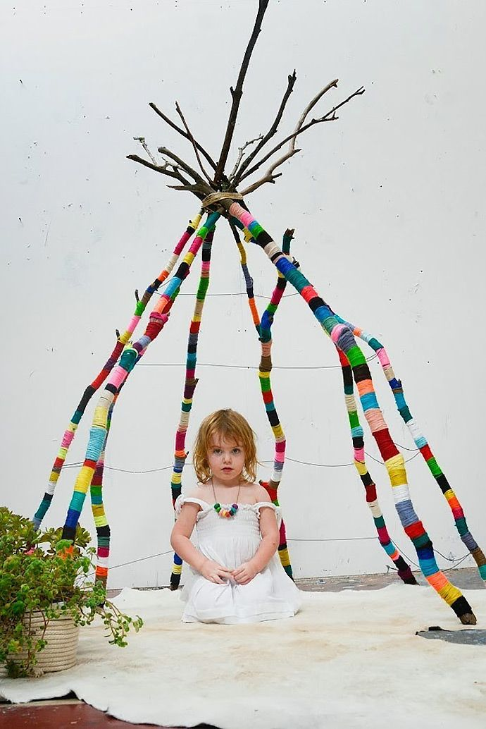 Cutest tent ideas for making your own for an afternoon, or something to keep up in their room for a super cute reading nook! DIY yarn wrapped branch teepee by Nathalie Miller