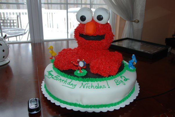 Elmo. Red Velvet Cake. Cupcake Eyes. Wilton's molds for balls used.