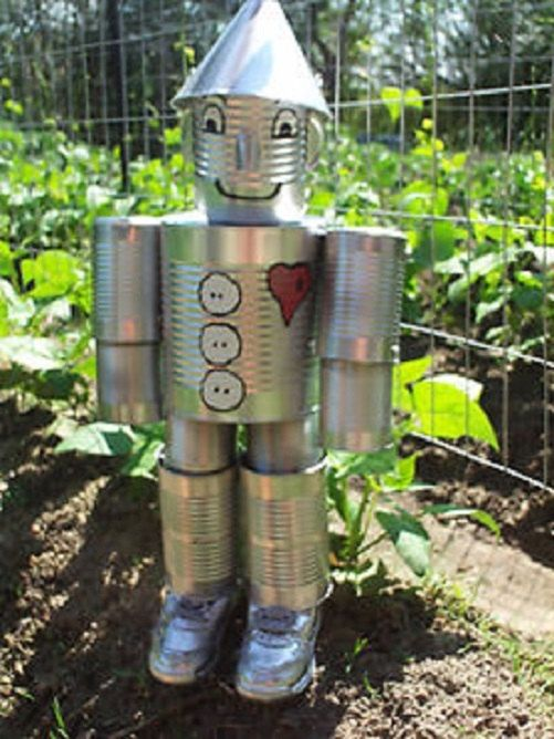 Hand crafted original tin can man the wizard of oz shoes for Tin man out of cans