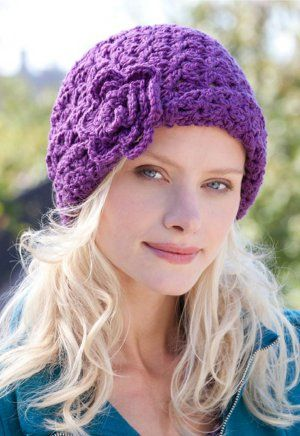 blooming purple beanie #crochet #pattern with an adorable crocheted flower on the side