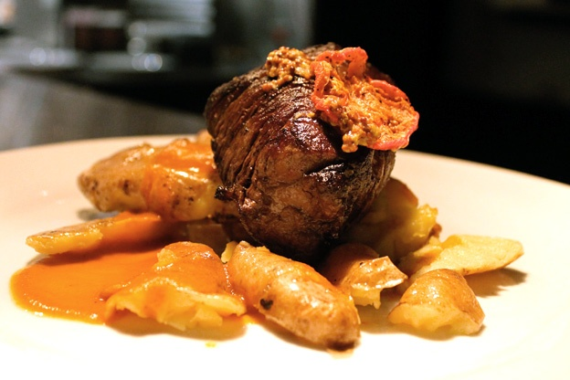 Beef tenderloin with crushed potatoes, tomato chips, grainy mustard ...