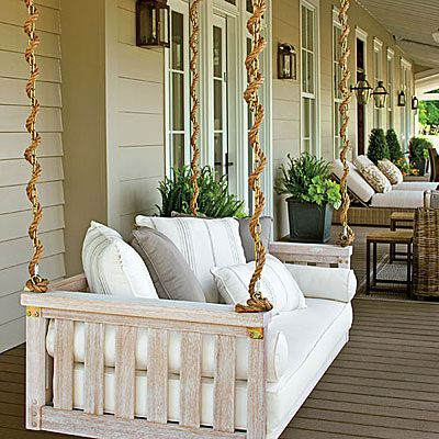 white farmhouse porch swing