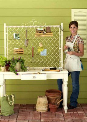 """Cyclone fence gate as back board to vintage  desk makes a practical potting bench. """"S"""" hooks can be used anywhere on it to hang your tools and more."""