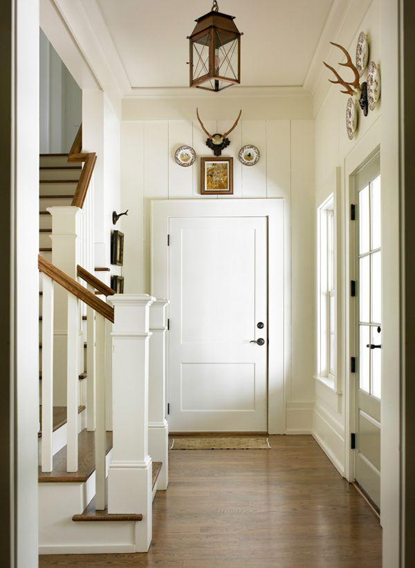 planked walls, antlers, and lantern pendant.  melanie davis