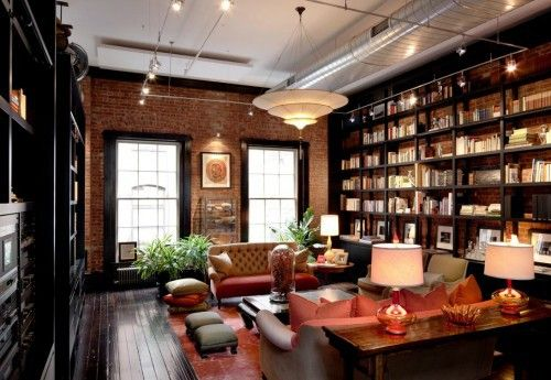 Gorgeous library in a loft. Love that they didn't try to cover up the heat and air vents.