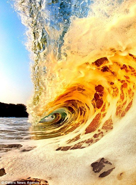 Beautiful waves...The breath-taking images show the split-second in which each one breaks and crashes on to the sand