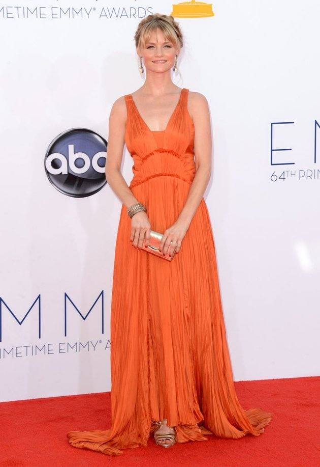 Lindsay Pulsipher was quite pretty in her flowy Bibhu Mohapatra orange gown, gold strappy sandals, braided updo, and drop earrings.