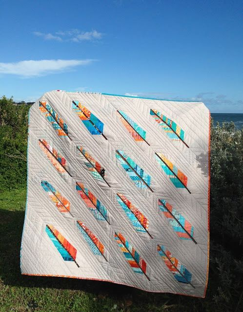 """Wonderful """"Birds of a Feather"""" quilt made with blocks from the Mid Century Modern Bee and Suz from PatchworknPlay. Even the signature blocks on the back make a cheerful quilt all on their own!"""