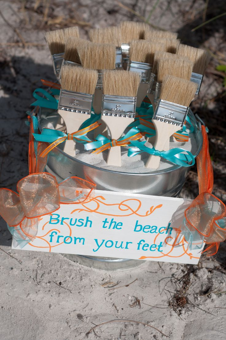 http://www.celebrationsoftampabay.com/ Paint Brushes are a great practical favor for a beach wedding to wipe the sand off your feet.