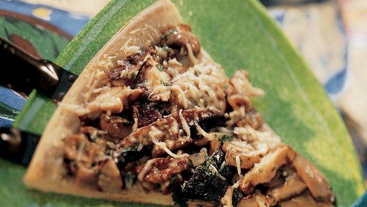 Onion, garlic, Parmesan and parsley top this tempting mushroom pizza.