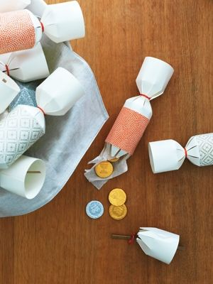 This festive craft combines two of kid-pleasing holiday activities — Gelt and Christmas crackers! Download our cracker template, and follow these simple how-tos with your little ones.