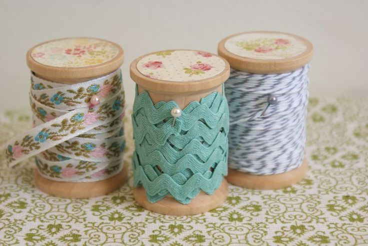Wooden spools prettied up with scrapbook paper and mod podge. *sigh*