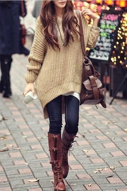 Tall boots over sized sweater.