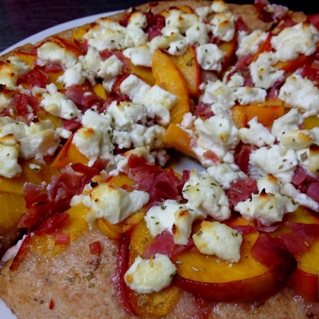 ... Peaches! This is a peach, prosciutto, goat cheese and rosemary pizza