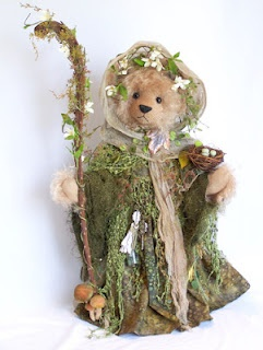 This is Woodlandia and she will be at the Quinlan doll and teddy bear show in May -- To find info on the show, click this link. http://www.quinlanmuseum.com/convention.html    To see my blog and the creative process in making this bear, click the pic