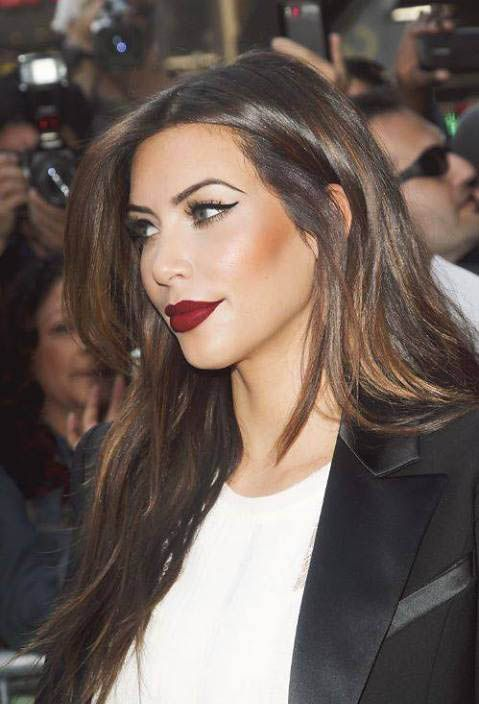 Kim Kardashian - makeup perfection for a night out.  whoever said you can't wear a bold lip and eye at the same time lied