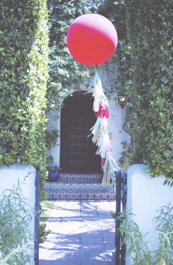 Oversized balloon with tissue tassels from @PaperFoxLA - perfect, on-trend decor for any party or shower!