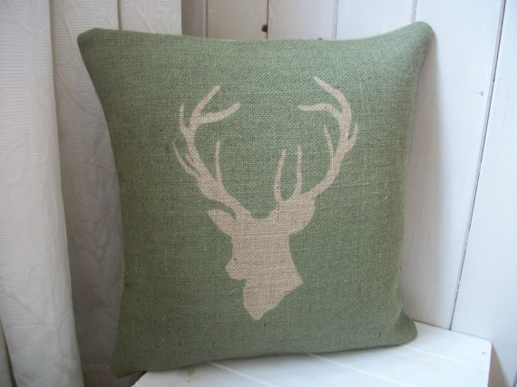 To go with my houndstooth, fire-side chair if I can get a black print on this colour material, which should match the walls.  Deer/Stags Head Hessian Cushion.  £18.65