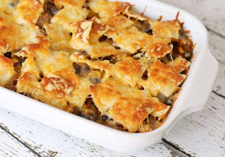 This Ground Beef Nacho Casserole with chiles, beans, and cheese is the ...