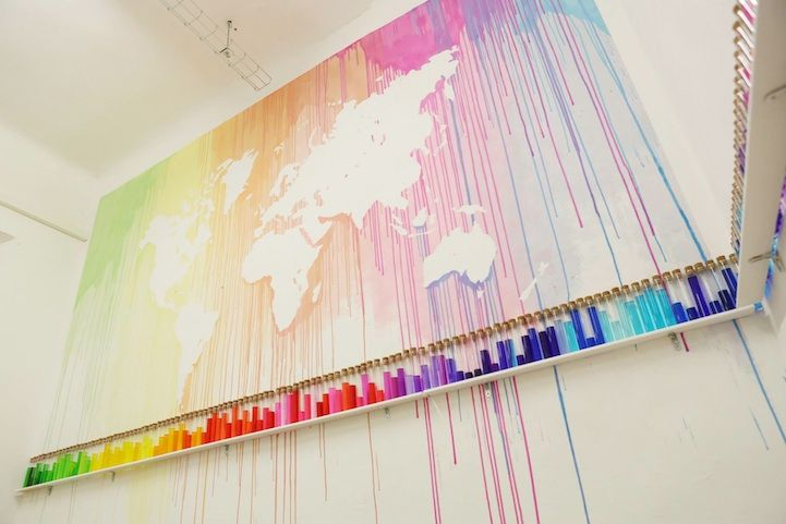 French Mademoiselle Maurice created a beautiful map of the world by dripping colorful paint, leaving the worlds seven continents in the negative. The art installation is part of her exhibition