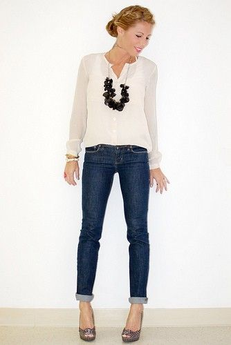 white blouse, jeans, and a chunky necklace are  great combo