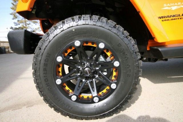 2012 Pimped out Jeep Wrangler Unlimited.  Features: Lift Kit, Colour Accented Rims and Off Road Tires.
