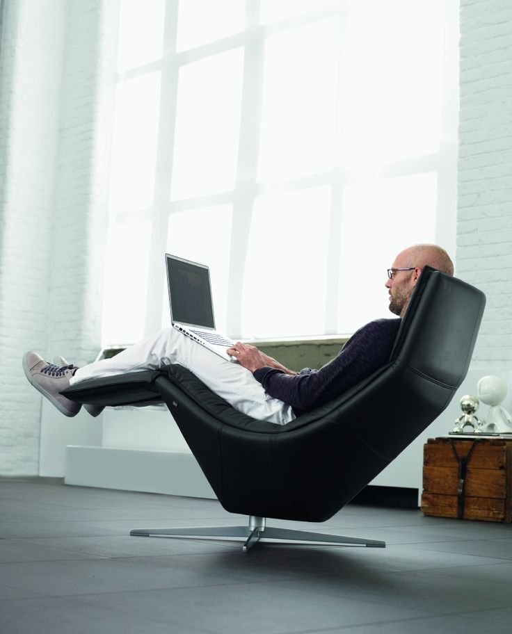 Office Workspace. Curve Black Leather Reclining Office Chair Set In The  Middle Of The Room With Wooden Desk
